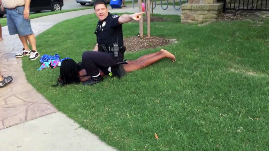 McKinney, Texas, police Cpl. Eric Casebolt is shown in a screenshot from video of an altercation Friday. Casebolt has been suspended after pulling his gun on a group of teenagers at a pool party. A witness, Brandon Brooks, uploaded this video of the incident to YouTube. Illustrates POLICE-CAMERAS (category a), by Marc Fisher and Peter Hermann © 2015, The Washington Post. Moved Monday, June 8, 2015. (MUST CREDIT: YouTube/Brandon Brooks.) Photo: HANDOUT, STR / Washington Post / THE WASHINGTON POST