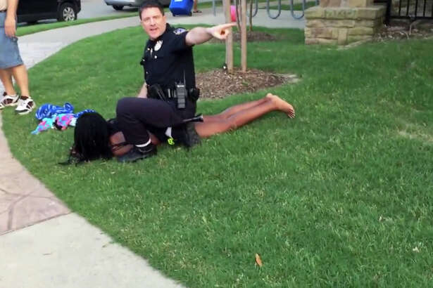 McKinney, Texas, police Cpl. Eric Casebolt is shown in a screenshot from video of an altercation Friday. Casebolt has been suspended after pulling his gun on a group of teenagers at a pool party. A witness, Brandon Brooks, uploaded this video of the incident to YouTube. Illustrates POLICE-CAMERAS (category a), by Marc Fisher and Peter Hermann © 2015, The Washington Post. Moved Monday, June 8, 2015. (MUST CREDIT: YouTube/Brandon Brooks.)