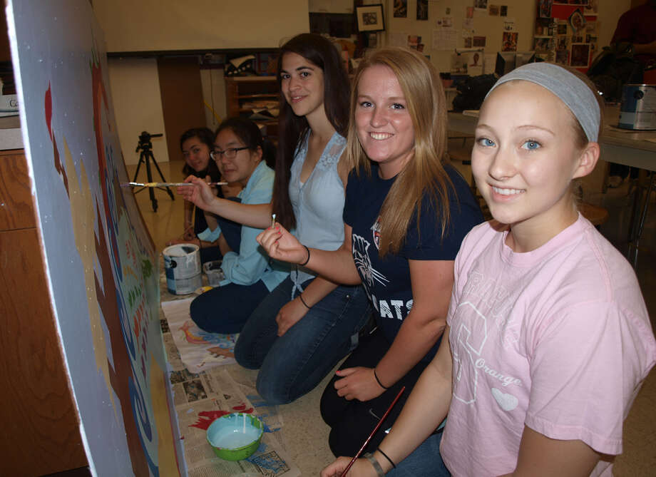 "Putting the finishing touches on their ""Once upon a Time"" mural are, from left, Hayley Chang, Alicia Chen, Eden Alin, Maggie O'Brien, and Emily Romano"""