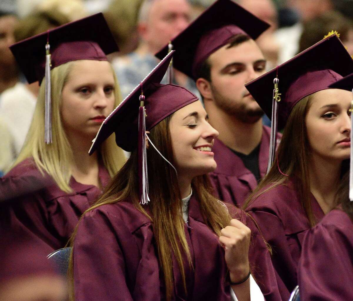 Michelle Veilleux sings along with the choir during Bethel High School Commencement Ceremony that was held at Western Connecticut State University's O'Neill Center on Thursday, June 18, 2015.