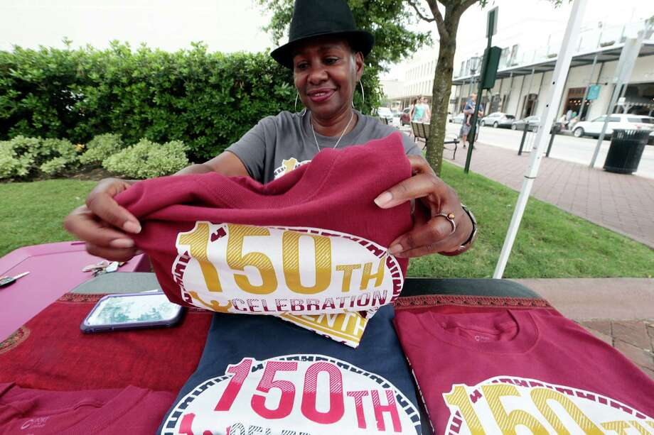 Leah Fanuiel is selling T-shirts in celebration of the 150th anniversary of when Texas slaves were freed.  Photo: Billy Smith II, Staff / © 2015 Houston Chronicle