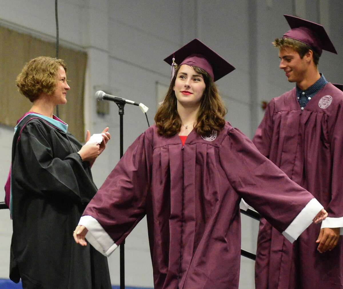Kaitlynn Dudley glides happily across the platform to receive her diploma during Bethel High Schools Commencement Ceremony that was held at Western Connecticut State University's O'Neill Center on Thursday, June 18, 2015.