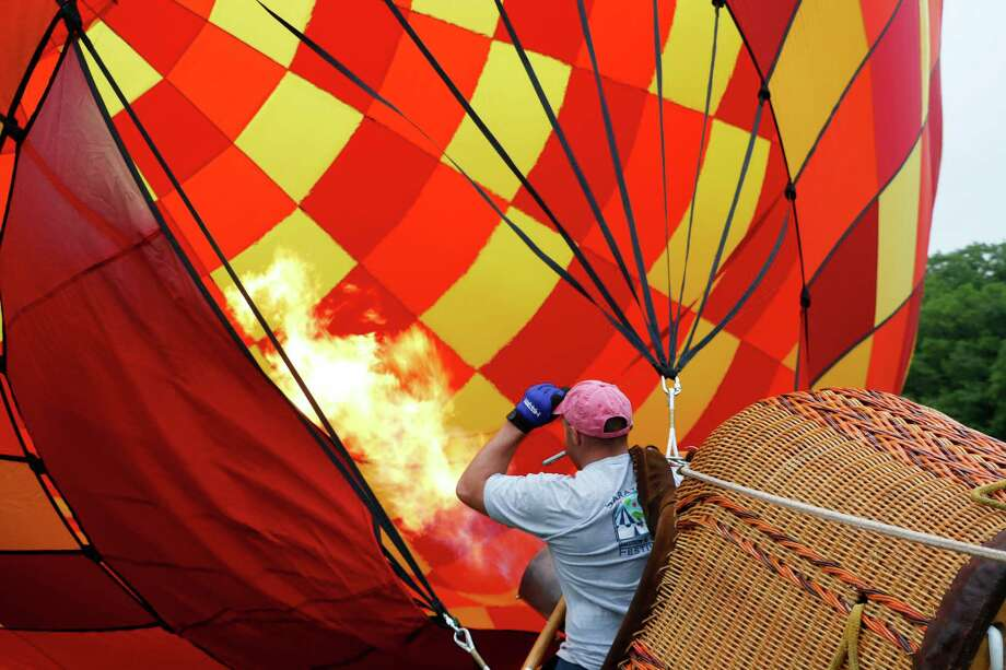 A hot air balloon is inflated at the Saratoga County Fairgrounds on Thursday, June 18, 2015, in Ballston Spa, N.Y. The Saratoga Balloon and Craft Festival will take place here from June 19-21 and offers balloon launches and glows, a juried Art & Craft section, kids activities, live entertainment, and food and beverages. (Olivia Nadel/ Special to the Times Union) Photo: ON / 00032227A
