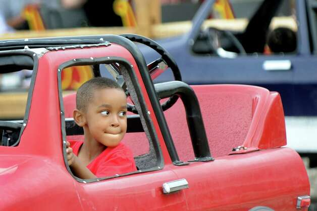 Haywood Watson, 6, of Albany gets to drive a vehicle on Thursday, June 18, 2015, at Huck Finn's Playland in Albany, N.Y. The park's rides were acquired from the former Hoffman's Playland, which closed at the end of last summer. (Cindy Schultz / Times Union) Photo: Cindy Schultz / 00032316B