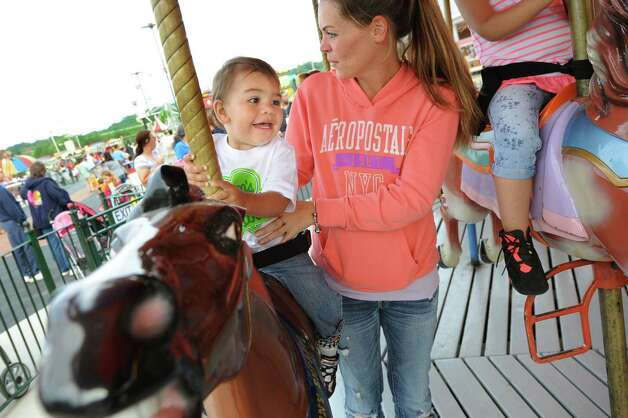 Jaxson Romero, 18 months, center, of Watervliet rides the carousel with his mother, Jessica Murphy, on Thursday, June 18, 2015, at Huck Finn's Playland in Albany, N.Y. (Cindy Schultz / Times Union) Photo: Cindy Schultz / 00032316B