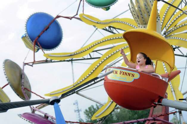 Jayden Langley, 6, of Clifton Park waves from the helicopter ride on Thursday, June 18, 2015, at Huck Finn's Playland in Albany, N.Y. (Cindy Schultz / Times Union) Photo: Cindy Schultz / 00032316B