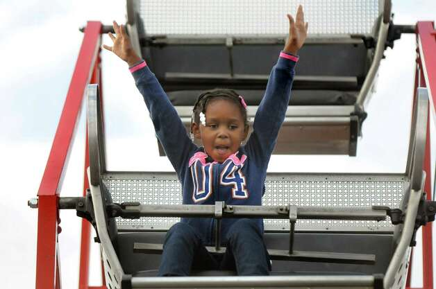 Alayshia Heath, 5, of Albany rides the child-sized Ferris wheel on Thursday, June 18, 2015, at Huck Finn's Playland in Albany, N.Y. (Cindy Schultz / Times Union) Photo: Cindy Schultz / 00032316B