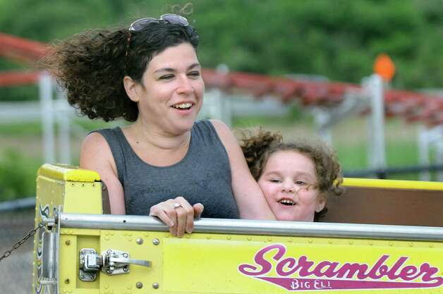Kacey Merhige, left, of East Greenbush rides the Scrambler with her daughter Emelia Merhige, 3, on Thursday, June 18, 2015, at Huck Finn's Playland in Albany, N.Y. (Cindy Schultz / Times Union) Photo: Cindy Schultz / 00032316B