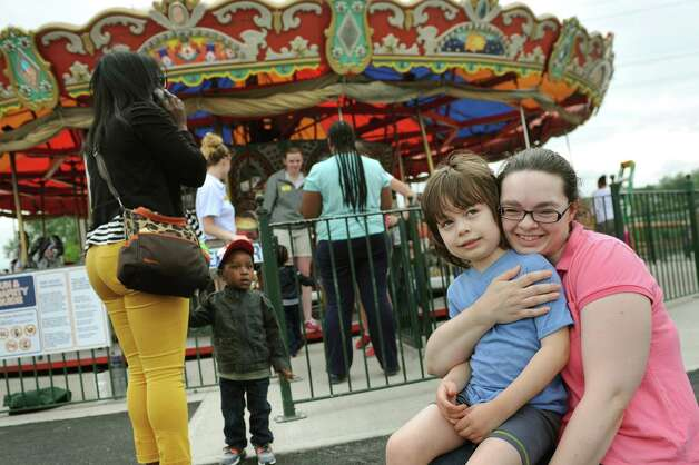 Laura Munn, right, of East Greenbush holds her son Johann Munn, 5, near the carousel on Thursday, June 18, 2015, at Huck Finn's Playland in Albany, N.Y. Laura Munn said her family's been on all these rides for generations.  (Cindy Schultz / Times Union) Photo: Cindy Schultz / 00032316B