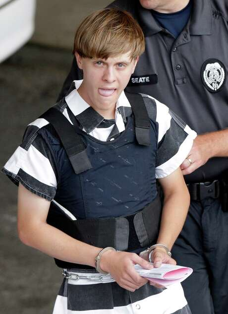 Charleston, S.C., shooting suspect Dylann Storm Roof is escorted from the Cleveland County Courthouse in Shelby, N.C., Thursday, June 18, 2015. Roof is a suspect in the shooting of several people Wednesday night at the historic The Emanuel African Methodist Episcopal Church in Charleston. (AP Photo/Chuck Burton) Photo: Chuck Burton, STF / AP