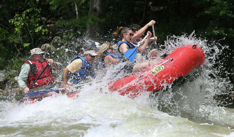 Turbulent water at Huaco Falls springs a boat into the air as river guides take groups down the Guadalupe River upstream from New Braunfels on June 18, 2015.  The extreme conditions on the river are safe for only the very experienced and knowledgeable expert . Photo: Tom Reel / San Antonio Express-News
