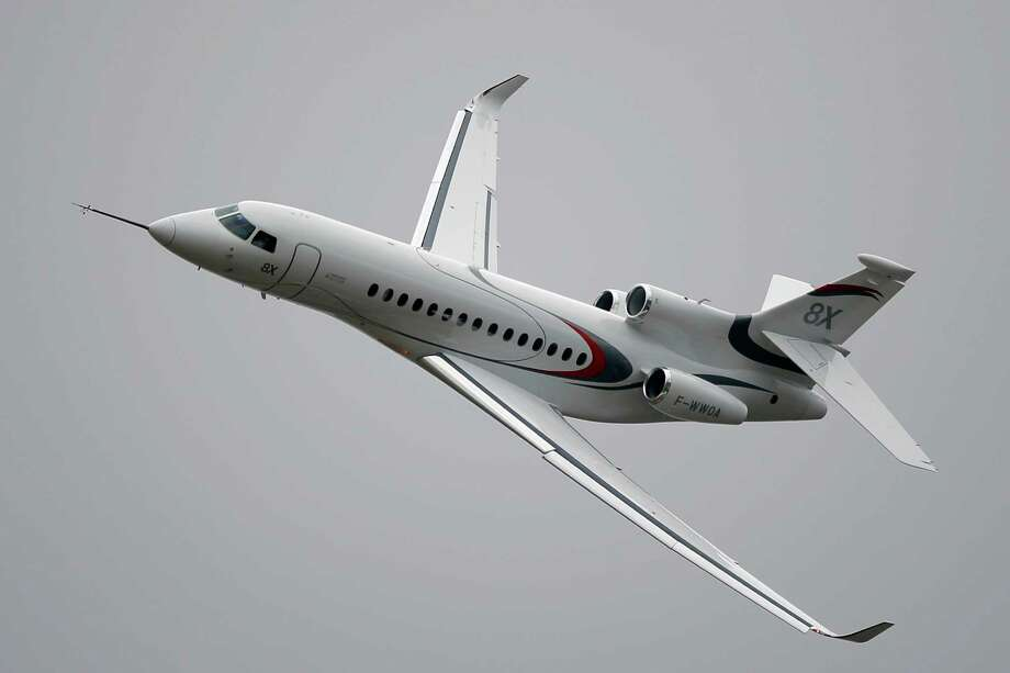 A new Falcon 8X performs its demonstration flight at the Paris Air Show, in Le Bourget airport, north of Paris, Thursday, June 18, 2015. Some 300,000 aviation professionals and spectators are expected at this week's Paris Air Show, coming from around the world to make business deals and see dramatic displays of aeronautic prowess and the latest air and space technology. (AP Photo/Francois Mori) Photo: Francois Mori, STF / AP