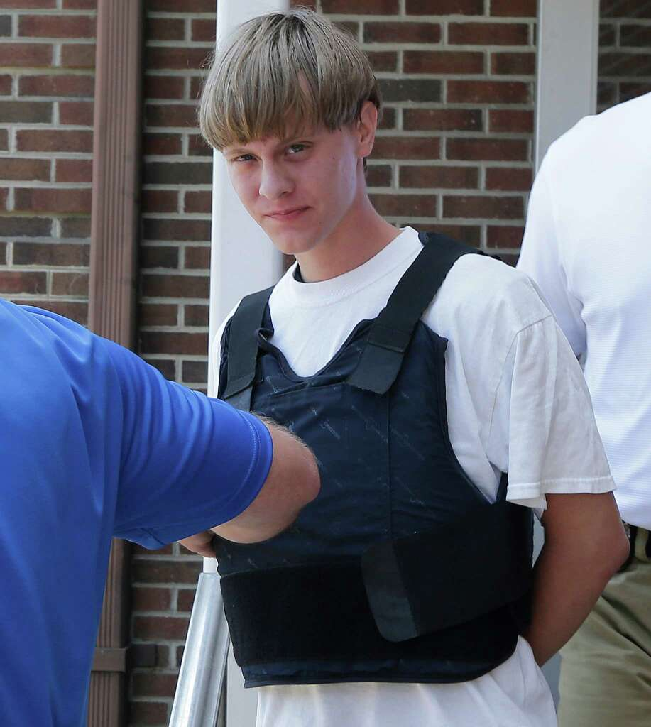 Charleston, S.C., shooting suspect Dylann Storm Roof is escorted from the ...