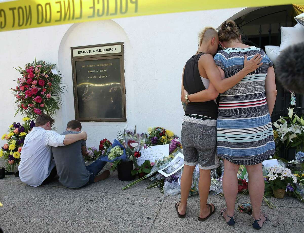 Click through this slideshow to seeInfamous hate crimes that have occurred in the U.S., elsewhere. South Carolina Church Shooting People hug as they pay their respects in front of Emanuel African Methodist Episcopal Church after a mass shooting at the church that killed nine people on June 18, 2015, in Charleston, South Carolina. A 21-year-old suspect, Dylann Roof of Lexington, South Carolina, was arrersted Thursday during a traffic stop. Emanuel AME Church is one of the oldest in the South. (Photo by Joe Raedle/Getty Images)
