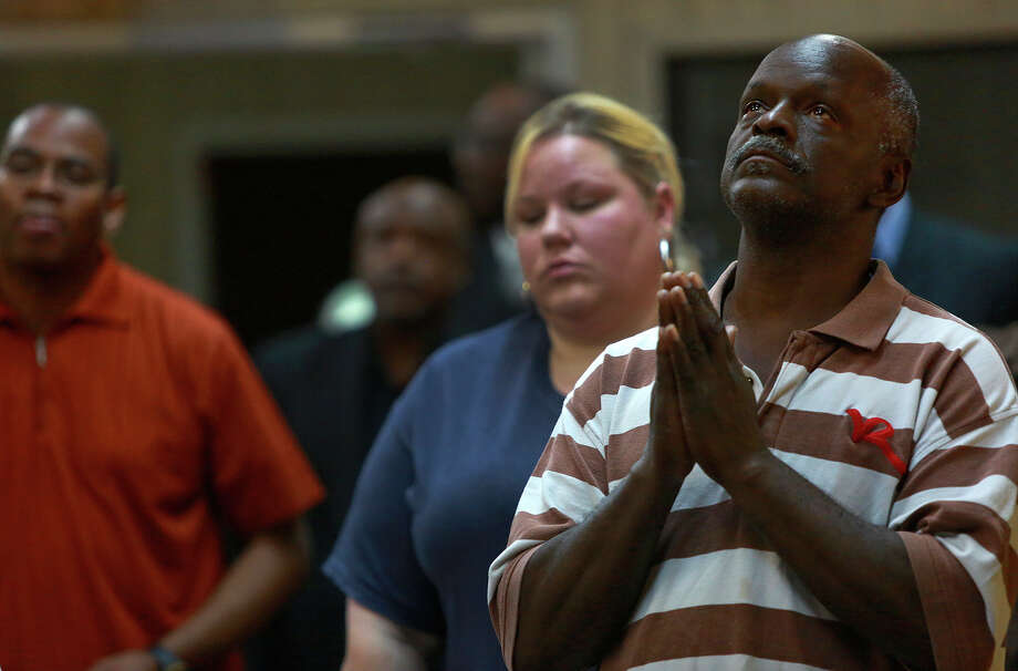 """Johnny Jones looks skyward after the singing of """"We Shall Overcome,"""" during a prayer vigil for the victims of the South Carolina church shooting at Greater Ball Tabernacle African Methodist Episcopal Church in San Antonio on Thursday, June 18, 2015. Photo: Lisa Krantz, Staff / San Antonio Express-News / San Antonio Express-News"""