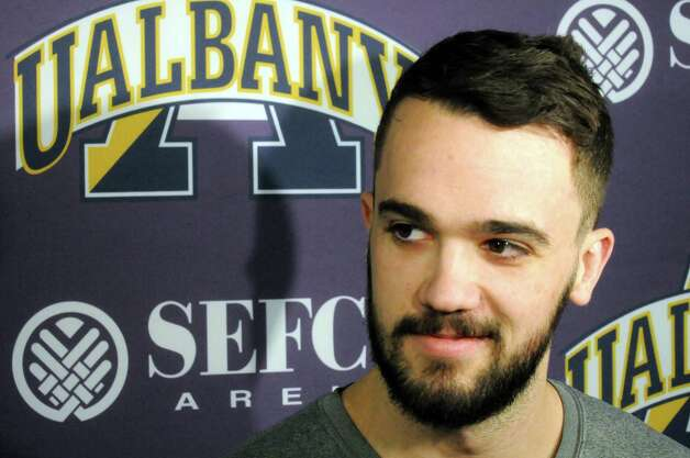UAlbany's Peter Hooley talks with the media prior to basketball practice at the SEFCU Arena on Tuesday March 17, 2015 in Albany, N.Y.  (Michael P. Farrell/Times Union) Photo: Michael P. Farrell / 00031069A