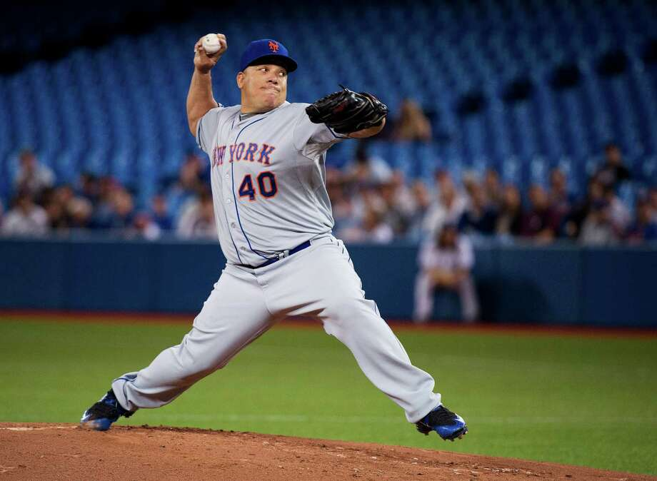 New York Mets starting pitcher Bartolo Colon works against the Toronto Blue Jays during the first inning of a baseball game Thursday, June 18, 2015, in Toronto. (Nathan Denette/The Canadian Press via AP) ORG XMIT: NSD103 Photo: Nathan Denette / The Canadian Press