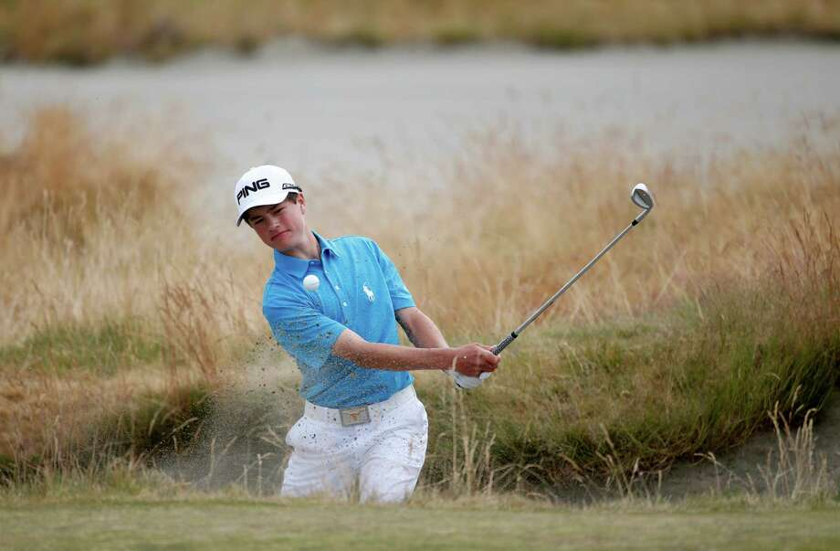 Cole Hammer, amateur, hits out of the bunker on the 15th hole during the first round of the U.S. Open golf tournament at Chambers Bay on Thursday, June 18, 2015 in University Place, Wash. (AP Photo/Lenny Ignelzi) Photo: Lenny Ignelzi, STF / AP