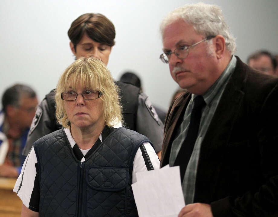 Joyce Mitchell stands with her lawyer Steven Johnston, appearing before Judge Buck Rogers in Plattsburgh City Court, New York, for a hearing Monday, June 15, 2015. She is charged with helping Richard Matt and David Sweat escape from the Clinton Correctional Facility near the Canadian border on June 6. Mitchell, 51, was charged Friday with supplying hacksaw blades, chisels, a punch and a screwdriver. Her lawyer entered a not guilty plea on her behalf.  (G.N. Miller/NY Post via AP, Pool) Photo: G.N. Miller, POOL / Associated Press / Pool New York Post