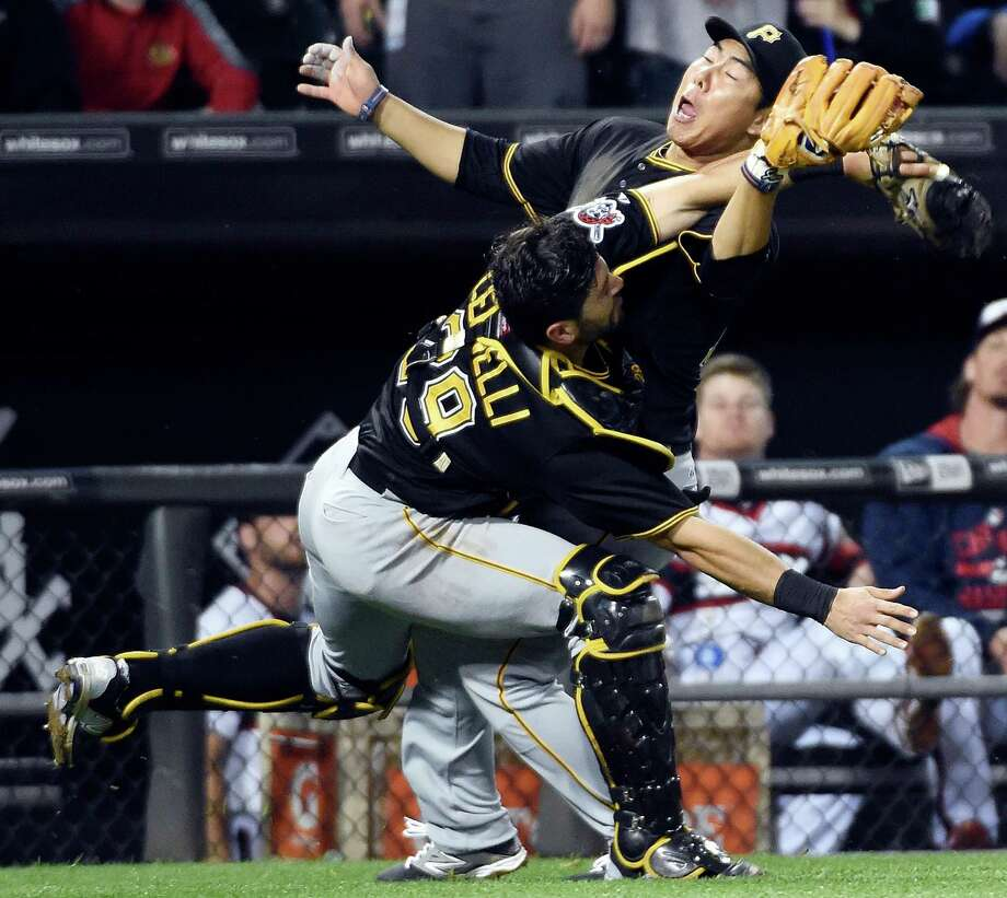 Pittsburgh Pirates catcher Francisco Cervelli (29) and third baseman Jung Ho Kang, right, collide as Cervelli catches a popup by Chicago White Sox's Geovany Soto during the seventh inning of a baseball game, Wednesday, June 17, 2015, in Chicago. (AP Photo/David Banks) Photo: DAVID BANKS, FRE / FR165605 AP