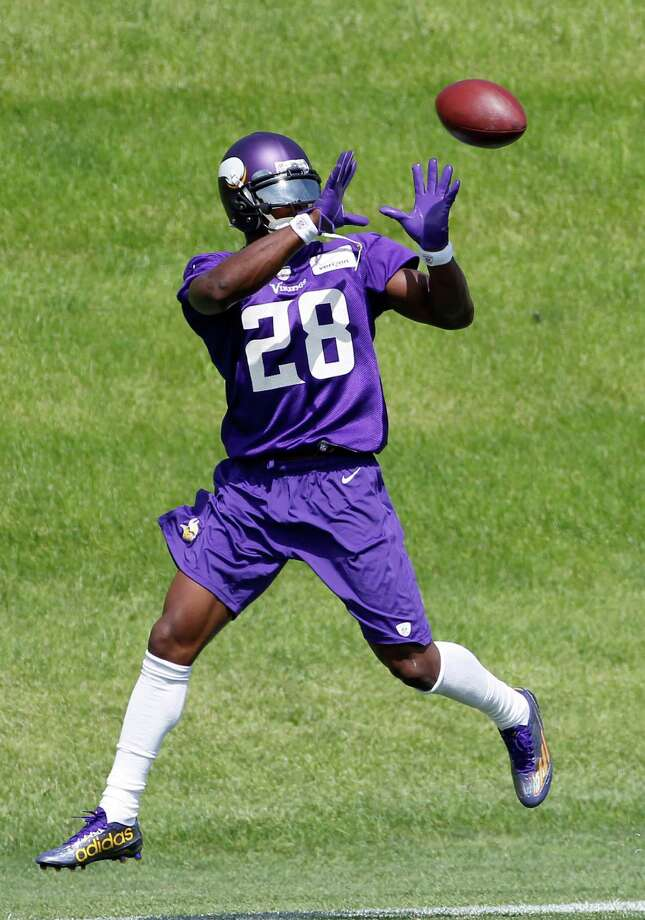 Minnesota Vikings running back Adrian Peterson catches a pass during NFL football minicamp in Eden Prairie, Minn., Thursday, June 18, 2015. (AP Photo/Ann Heisenfelt) ORG XMIT: MNAH106 Photo: Ann Heisenfelt / FR13069 AP