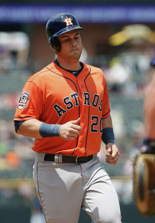 Houston Astros' Preston Tucker crosses home plate after hitting a solo home run against the Colorado Rockies in the first inning of an interleague baseball game Thursday, June 18, 2015, in Denver. (AP Photo/David Zalubowski) Photo: David Zalubowski, STF / AP
