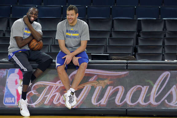 Draymond Green (left) took David Lee's starting position at the start of the season and then, in Game 3 of the NBA Finals, received a lesson from Lee about attacking on offense. They sat together as champions on the flight home after Game 6.