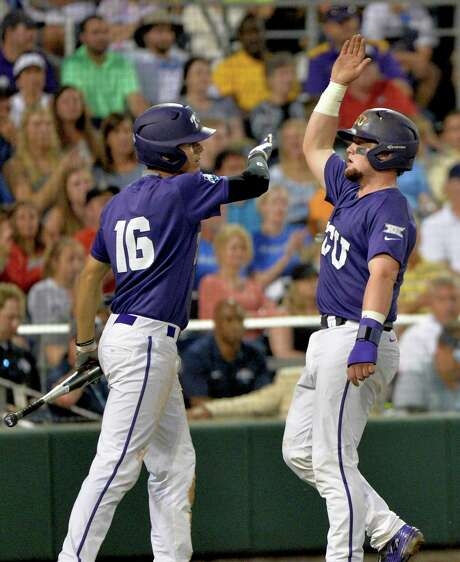 TCU's Connor Wanhagen (16) and Evan Skoug celebrate after scoring on Dane Steinhagen's fifth-inning single in Thursday night's 8-4 win over LSU. Photo: Ted Kirk, FRE / FR34398 AP