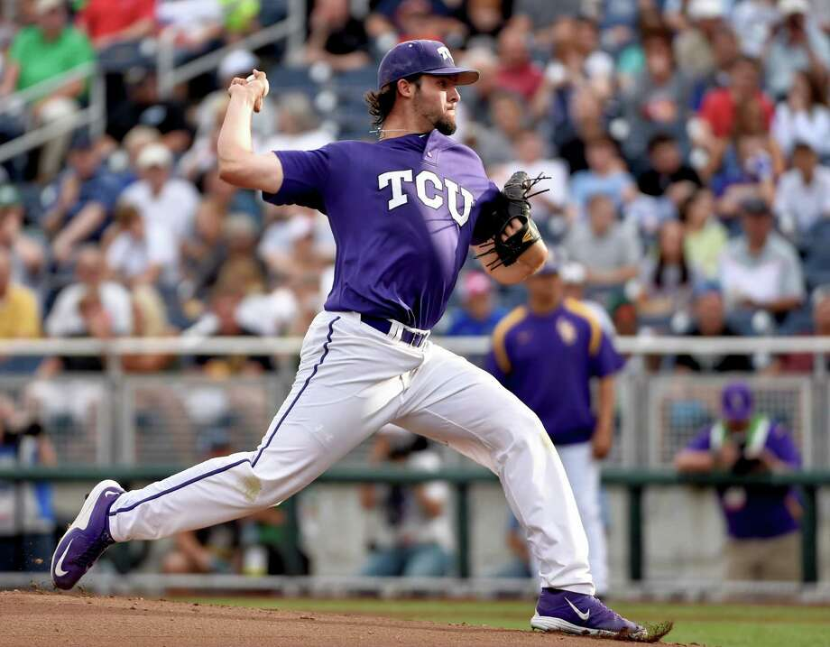 TCU starting pitcher Mitchell Traver throws in the first inning of an NCAA College World Series baseball elimination game against LSU in Omaha, Neb., Thursday, June 18, 2015. (AP Photo/Mike Theiler) ORG XMIT: NENH104 Photo: Mike Theiler / FR170180 AP