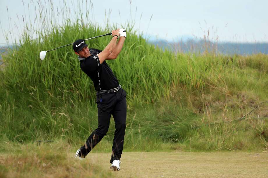 UNIVERSITY PLACE, WA - JUNE 18:  Dustin Johnson of the United States hits his tee shot on the 11th hole during the first round of the 115th U.S. Open Championship at Chambers Bay on June 18, 2015 in University Place, Washington.  (Photo by Mike Ehrmann/Getty Images) ORG XMIT: 527960297 Photo: Mike Ehrmann / 2015 Getty Images