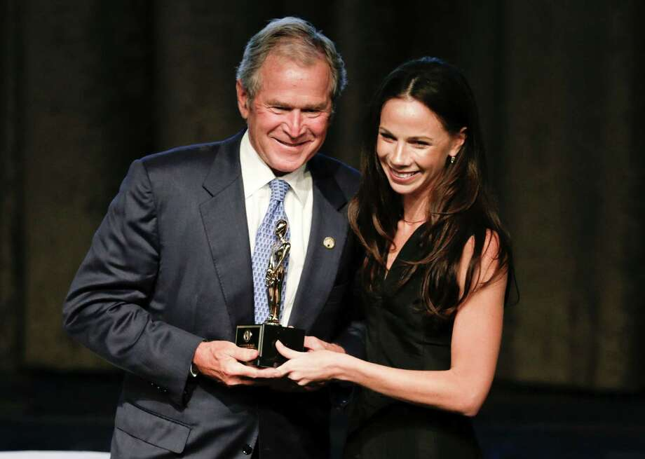 Former President George W. Bush, left, poses with his daughter, Barbara, after receiving an award at the 74th Annual Father of the Year Awards benefit luncheon Thursday, June 18, 2015, in New York. (AP Photo/Frank Franklin II) ORG XMIT: NYFF108 Photo: Frank Franklin II / AP