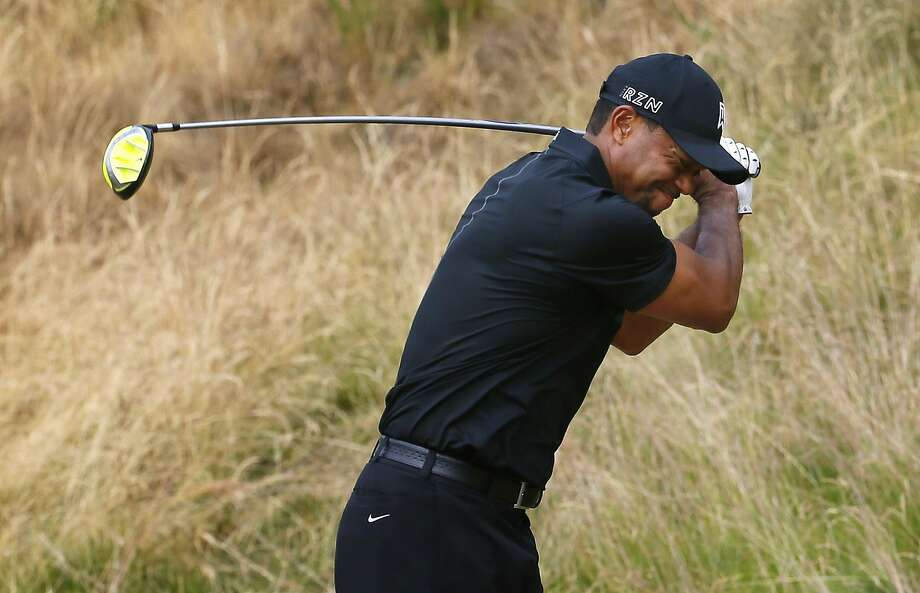 Tiger Woods reacts to his tee shot on the eighth hole during his first grim round of the U.S. Open. Photo: Matt York, Associated Press