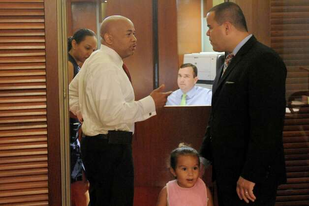 Speaker of the New York State Assembly Carl E. Heastie, left, talks with Assemblyman Marcos A. Crespo who had his two-year-old daughter Raquel Crespo with him at the Capitol on Thursday June 18, 2015 in Albany, N.Y.  (Michael P. Farrell/Times Union) Photo: Michael P. Farrell / 00032332A