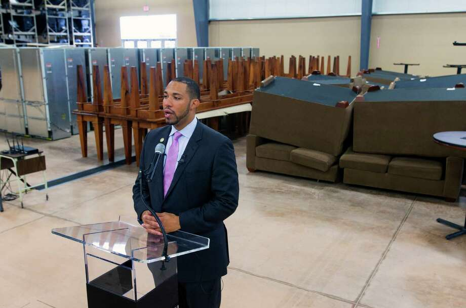 Commissioner Tommy Calvert holds a news conference  in one of the buildings that is currently holding materials being removed from the AT&T Center. Photo: William Luther /San Antonio Express-News / © 2015 San Antonio Express-News