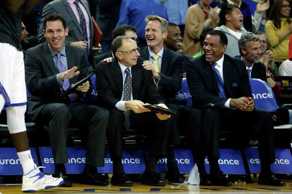 (left to right) Golden State Warriors' coaches Luke Walton, Ron Adams, Steve Kerr and Alvin Gentry enjoy a block by rookie James Michael McAdoo in 4th quarter of Warriors' 122-79 win over the Denver Nuggets during NBA game at Oracle Arena in Oakland, Calif. on Monday, January 19, 2015.