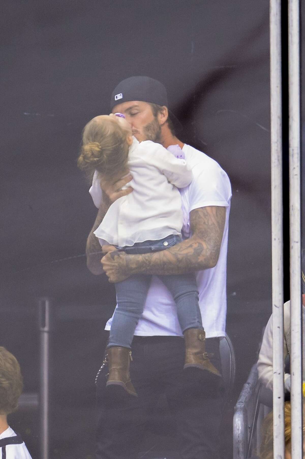 Harper Beckham and David Beckham have some quality daddy/daughter time at an L.A. Kings hockey game. Beckham is also dad to three sons with wife Victoria Beckham.