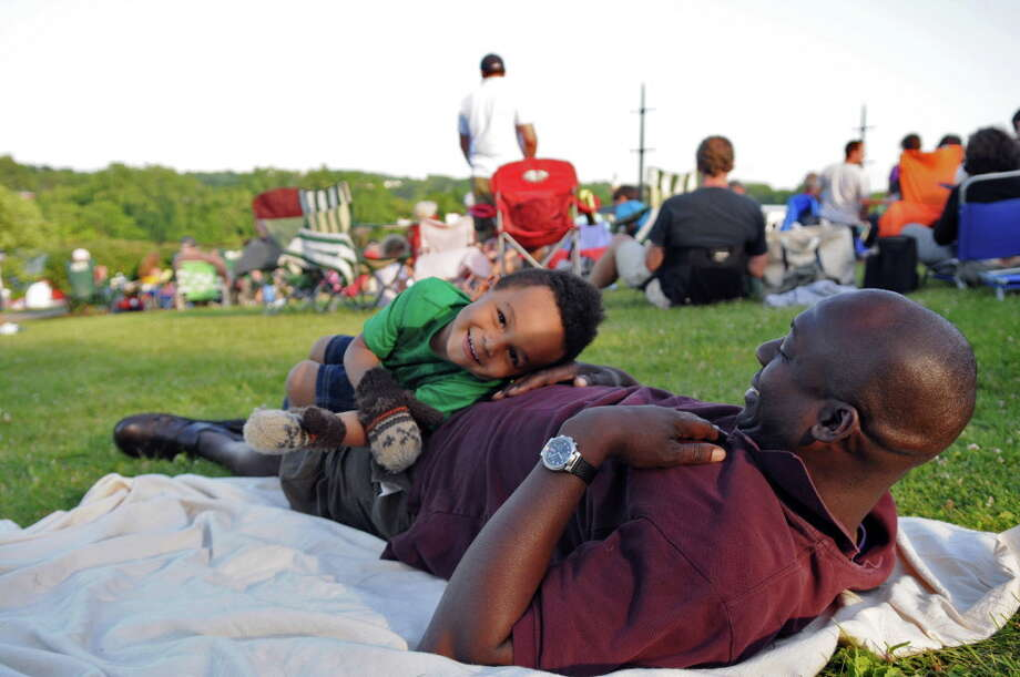 Aaron Caton of Albany plays with his son Jude, 3, during the 10th Annual Albany Father's Day Concert at Albany Riverfront Park, on Sunday evening June 17, 2012 in Albany, NY. (Philip Kamrass / Times Union archive) Photo: Philip Kamrass / 00018105A