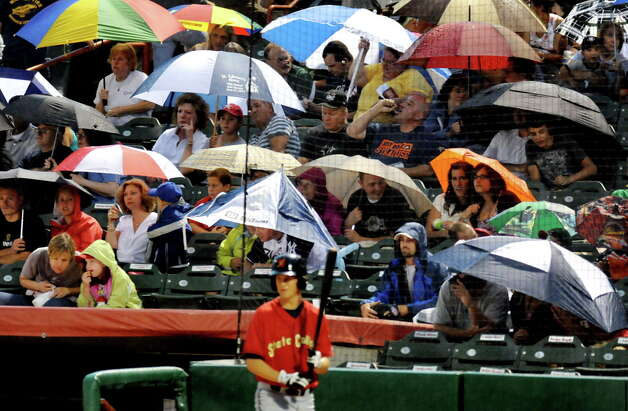 ValleyCats fans pop open their umbrellas and take cover when the rain starts during their baseball game against State College on Friday, July 29, 2011, in Troy, N.Y. (Cindy Schultz / Times Union archive) Photo: Cindy Schultz / 00014033C