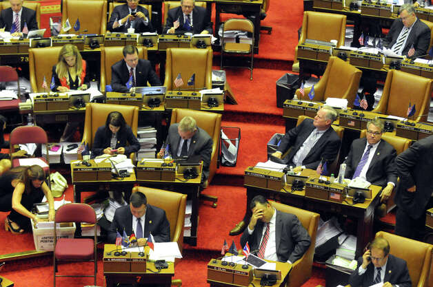 New York State Assembly members pass bills during session at the Capitol on Thursday June 18, 2015 in Albany, N.Y.  (Michael P. Farrell/Times Union) Photo: Michael P. Farrell, Albany Times Union / 00032332A