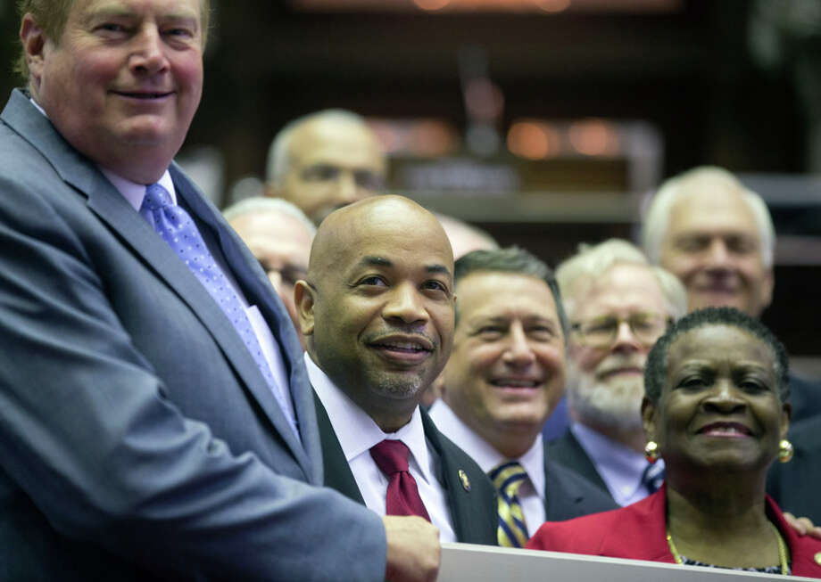 Assembly Speaker Carl Heastie, D-Bronx, second from left, poses for a photo with members who have served 10 years, in the Assembly Chamber at the Capitol on Thursday, June 18, 2015, in Albany, N.Y. Tired lawmakers have returned to the Capitol for another day as leaders continue to search for a deal to end a showdown over New York City's lapsed rent regulations. (AP Photo/Mike Groll)  ORG XMIT: NYMG102 Photo: Mike Groll, AP / AP