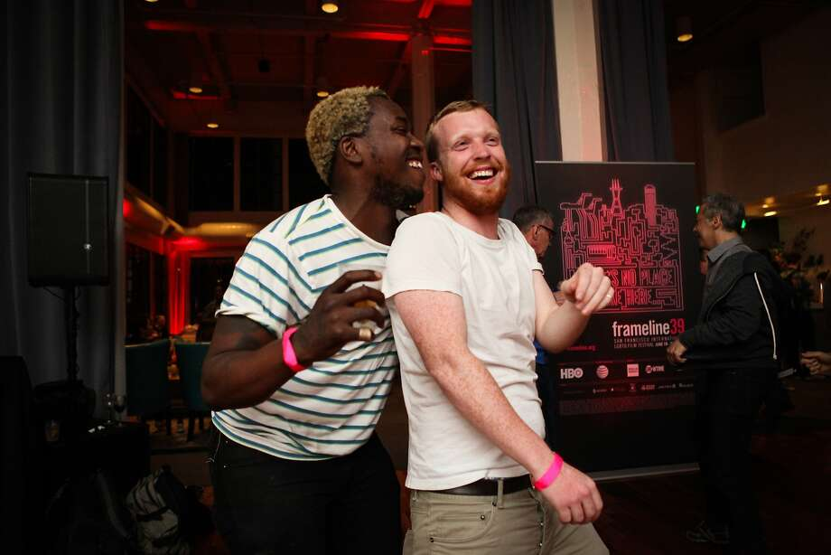 Brontez Purnell (left) dances with Anthony Harbin (right) at the opening night of the Frameline film festival which celebrated at Terra Gallery where festival attendees enjoyed local cuisine, desserts and music in San Francisco, California, on Thursday, June 18, 2015. Photo: Gabrielle Lurie, Special To The Chronicle