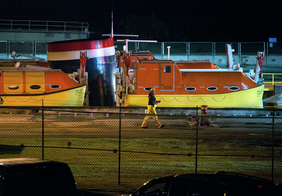 A man walks past the top of the Saint Laurent cruise ship Thursday, June 18, 2015, after an accident in Massena, N.Y.  Authorities say the cruise ship crashed into a wall in a lock on the St. Lawrence Seaway, injuring 17 people and forcing the draining of the lock. (Jason Hunter/The Watertown Daily Times via AP) Photo: Jason Hunter / The Watertown Daily Times