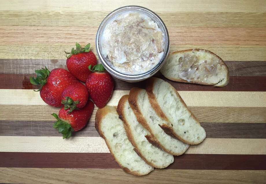 Pork rillettes are perfect picnic fare: Pork simmered slowly in its own fat, shredded and stored in that fat. Photo: Edmund Tijerina /San Antonio Express-News
