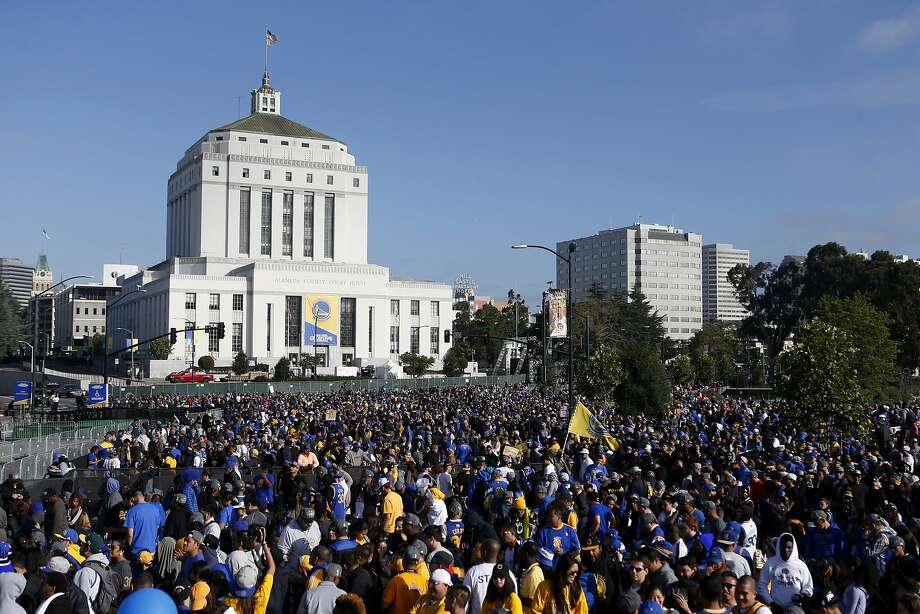 Fans wait for the Golden State Warriors NBA Champions rally at the Henry J. Kaiser Convention Center on Friday, June 19, 2015 in Oakland, Calif. Photo: Beck Diefenbach, Special To The Chronicle