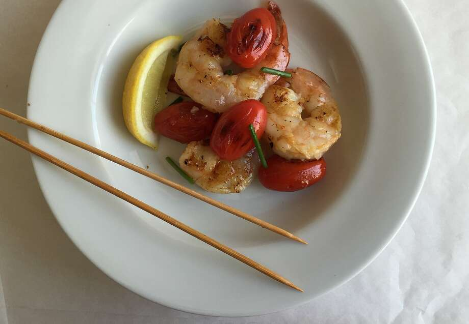 Serve the finished shrimp and tomato skewers with rice, pasta or salad Photo: Amanda Gold