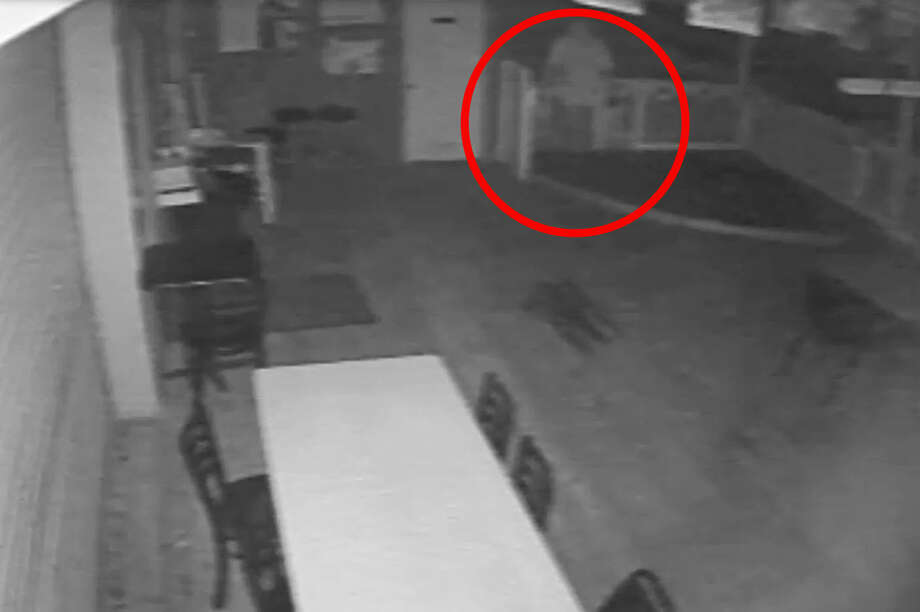 An arson suspect was caught on tape Thursday, June 11, 2015 pouring a flammable liquid in the back porch of the Cross Track Ice House in Old Town Spring before setting the porch on fire. Crime Stoppers is offering a $5,000 reward for anyone with information leading to an arrest. Anonymous tips can be made at 713-222-8477. Photo: Harris County Fire Marshal