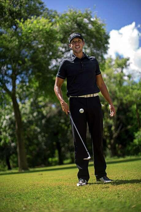 Longtime San Antonio resident and former St. Mary's University golfer K.C. Lim poses for a portrait at Brackenridge Park Golf Course in San Antonio. Photo: Ray Whitehouse /San Antonio Express-News / 2015 San Antonio Express-News