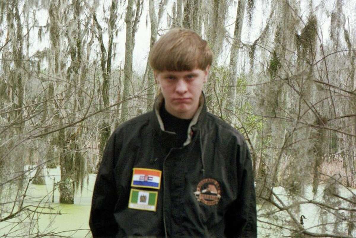 Dylann Storm Roof is pictured in this Facebook photo wearing a jacket featuring the apartheid flag of South Africa and the Rhodesian flag, two prominent symbols in the white power movement.