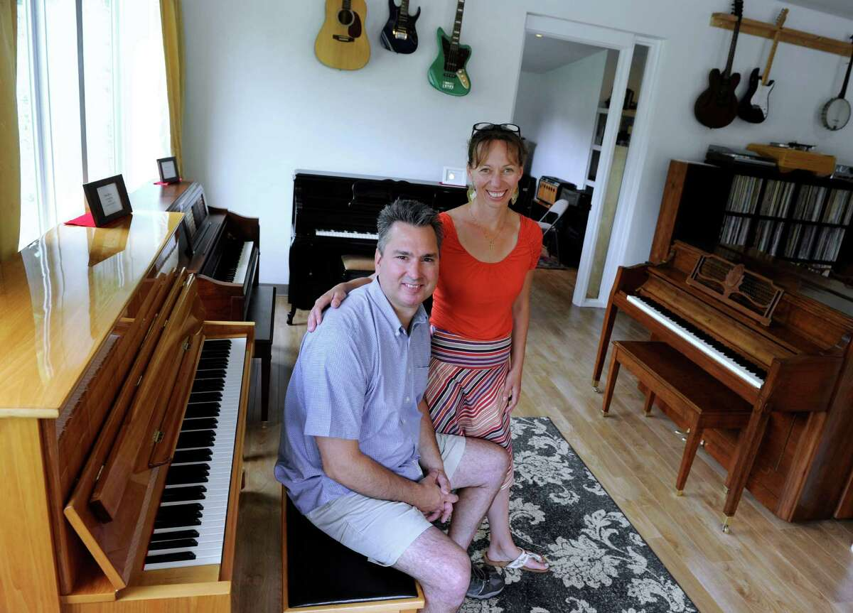 Damon and Sarah Wade, owners of Wade's Piano Center on Nashville Road in Bethel, are photographed Thursday, June 18.