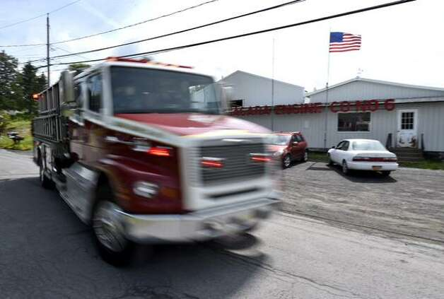 Schoharie's Niagara Engine Company 6 got two calls during an announcement on Friday, June 19, 2015, of FEMA funds for a new fire house. (Skip Dickstein/Times Union)